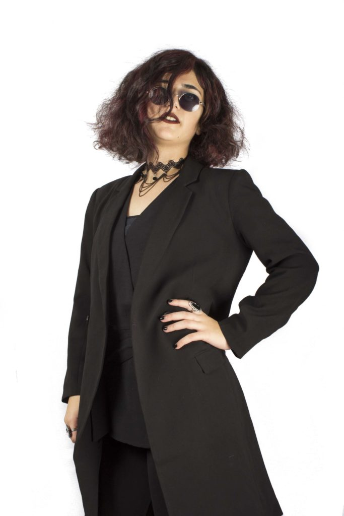 a photo of a woman in black and dark sunglasses