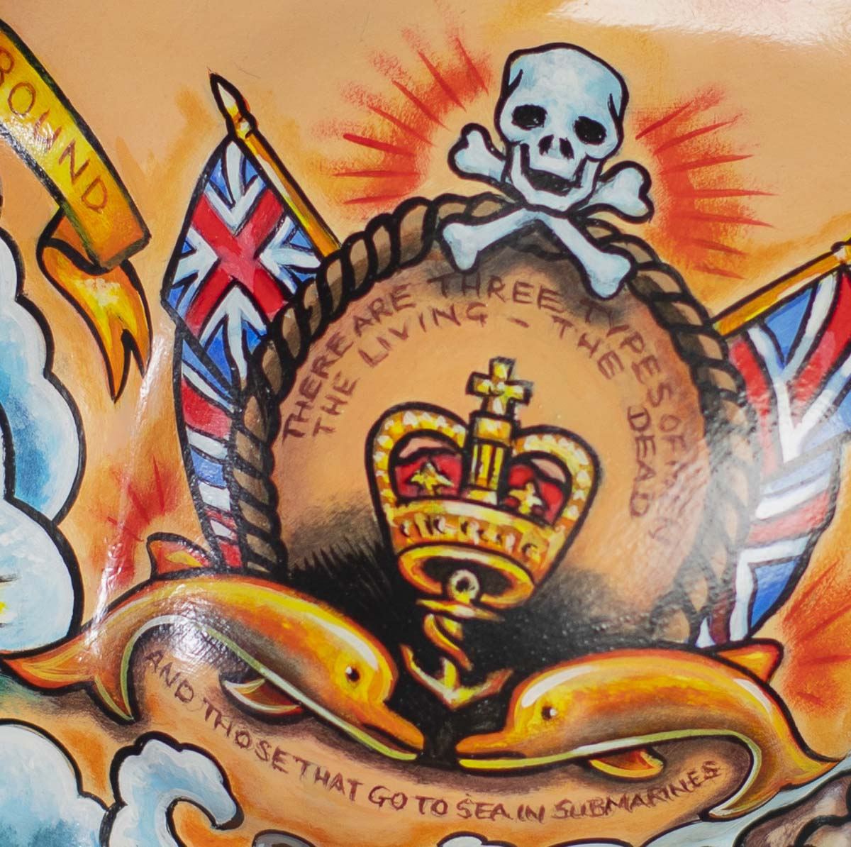 a detail of a tattoo design that says there are three types of man the living, the dead and those that go to sea in submarines