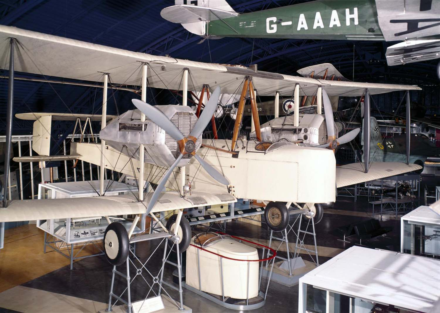 a photo of a large biplane suspended in a museum gallery
