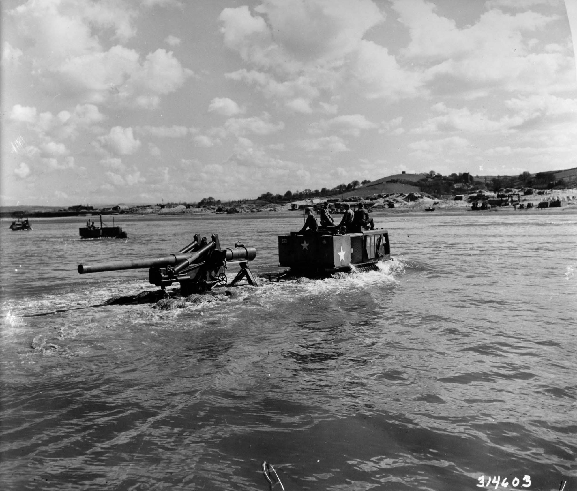a photo of an artillery piece being towed across the sea