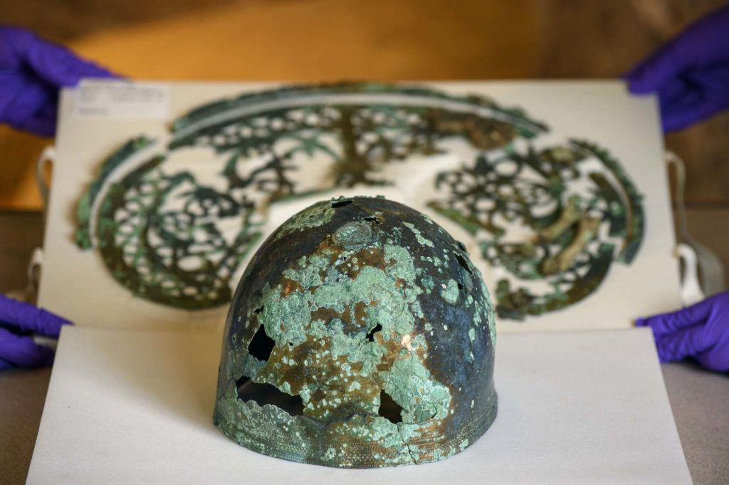a photof the remnants of a helmet and metalworked crest