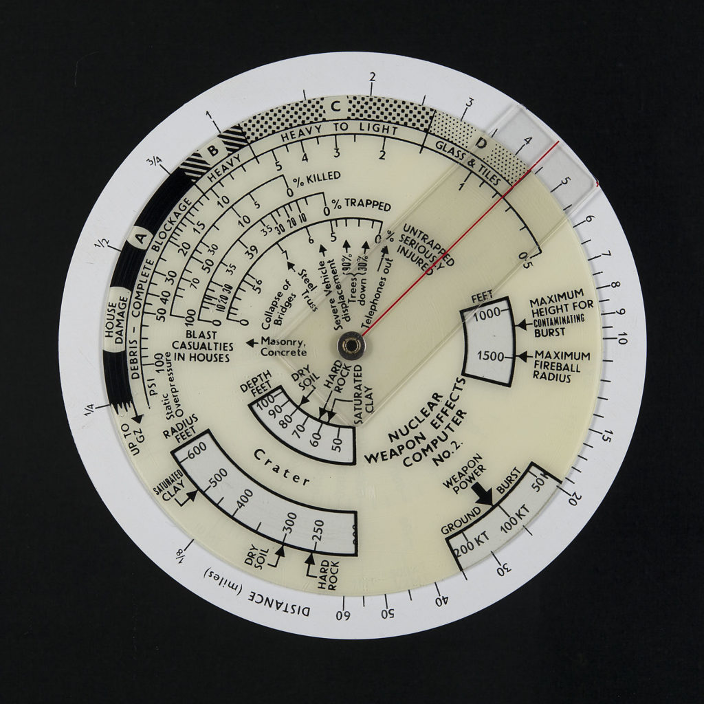 a disk with dials and various measurements with writing about blast casualties and deaths
