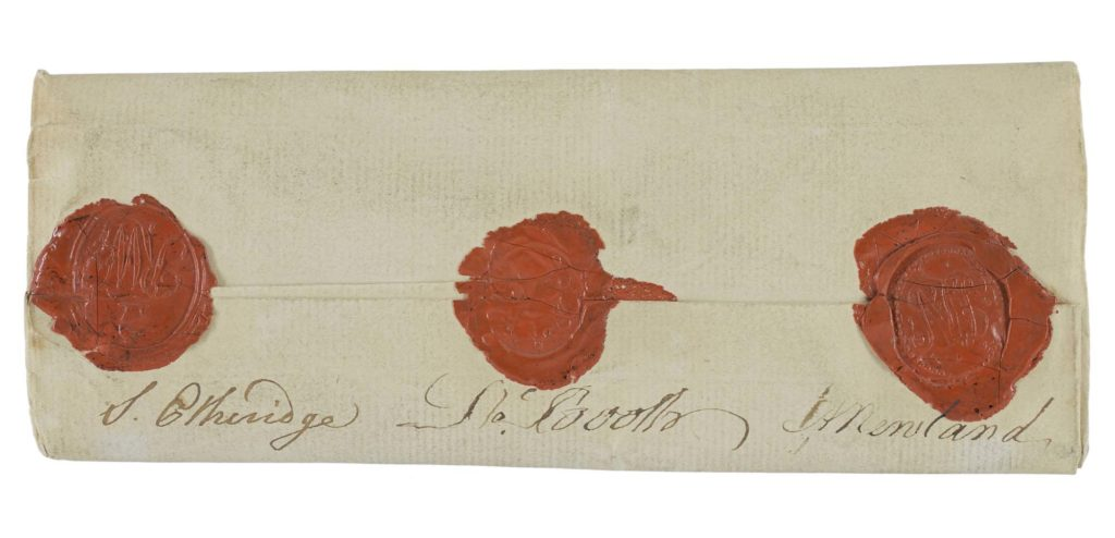 an odl piece of packet paper with three red wax seals