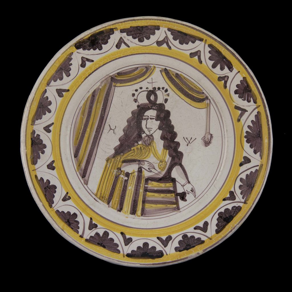 a decorated plate showing a representation of William of Orange