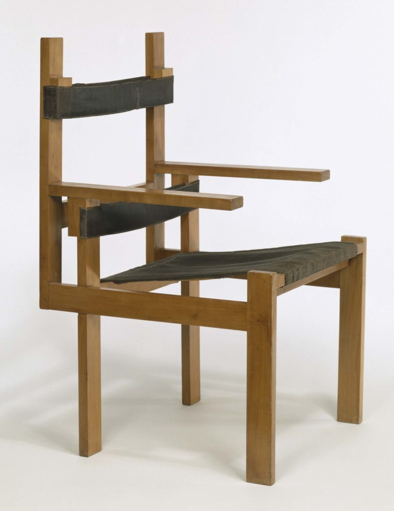 a photo of an angular armchair with unusual back and arms