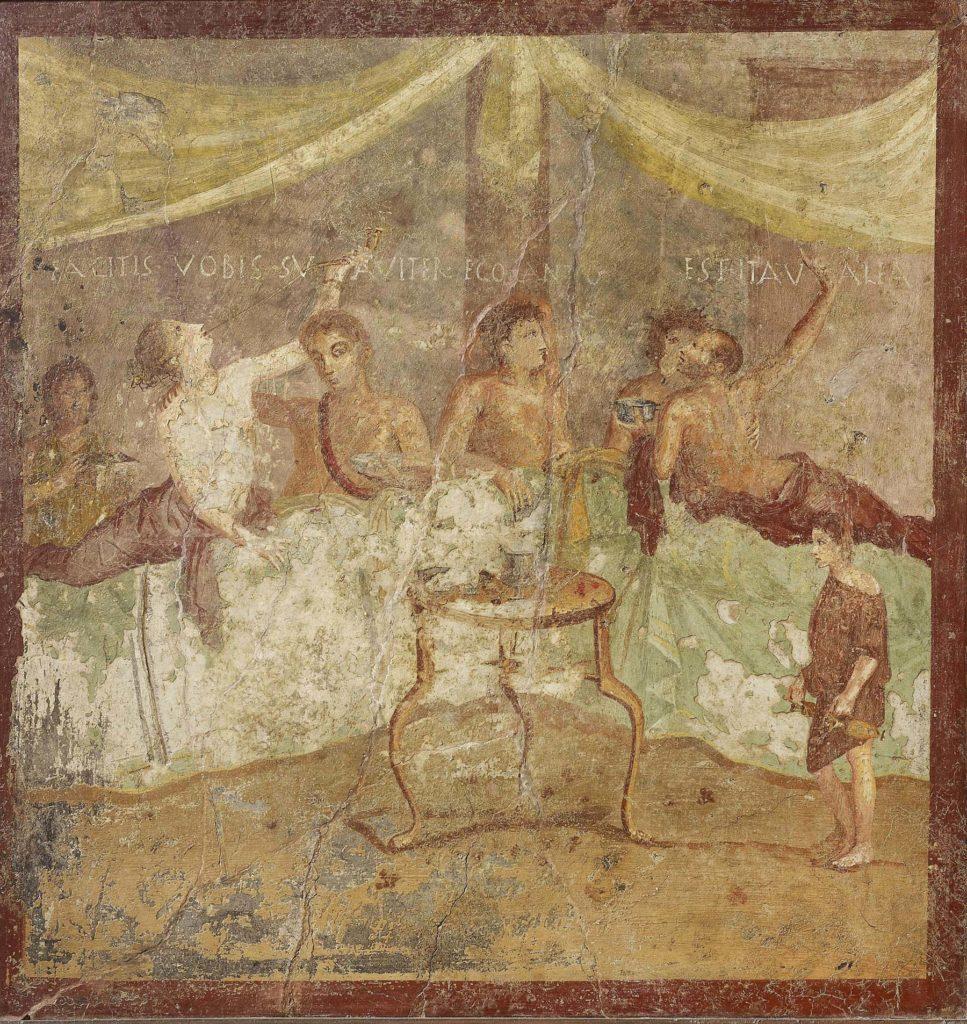 a fresco showing Romans feasting