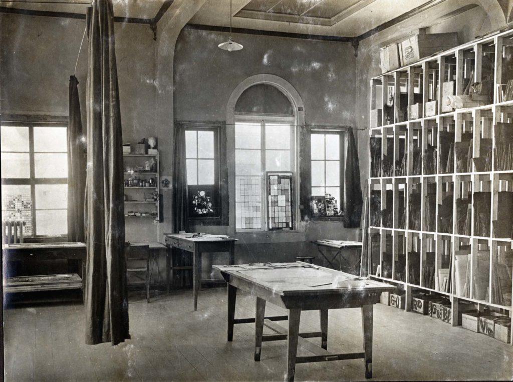a black and white photo of a studio interior