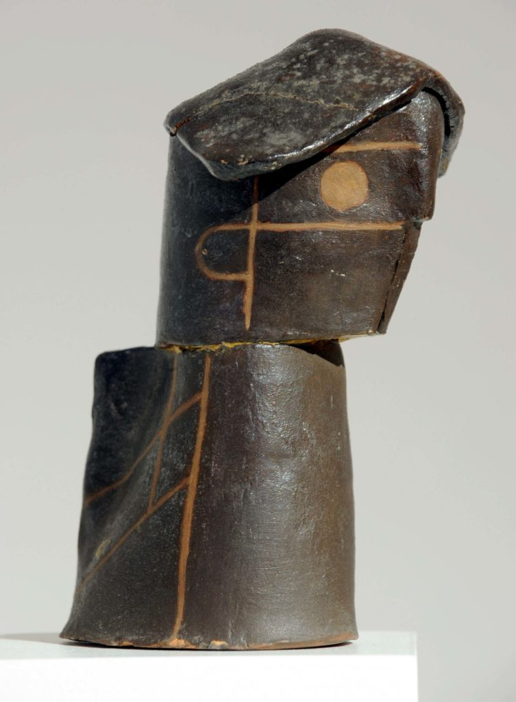 an abstract modernist sculpture of a female head
