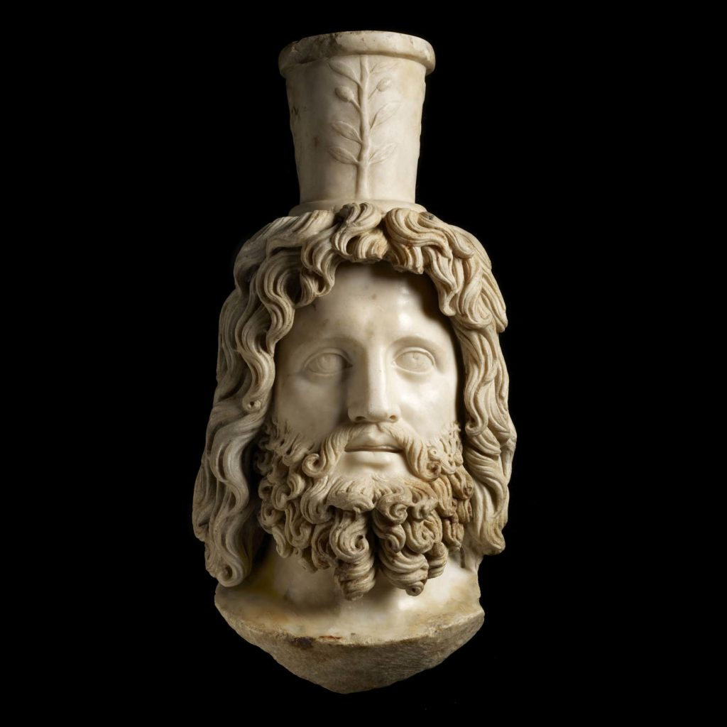 a vessel in the shape of a bearded man with a funnel coming from his head