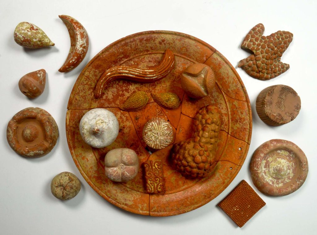 a photo of a plate with food made from ceramic