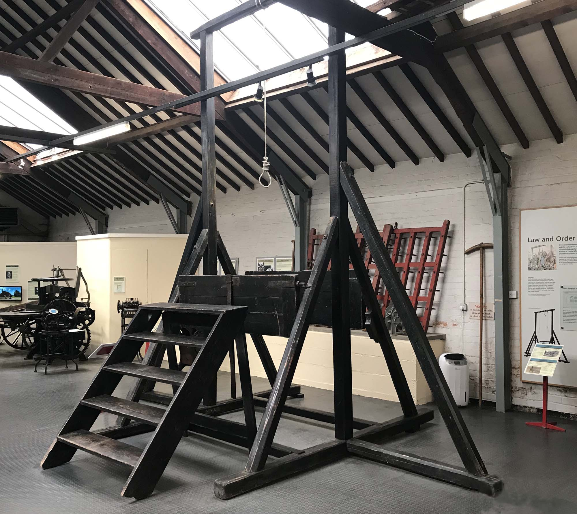 a photo of a wooden gallows in museum gallery