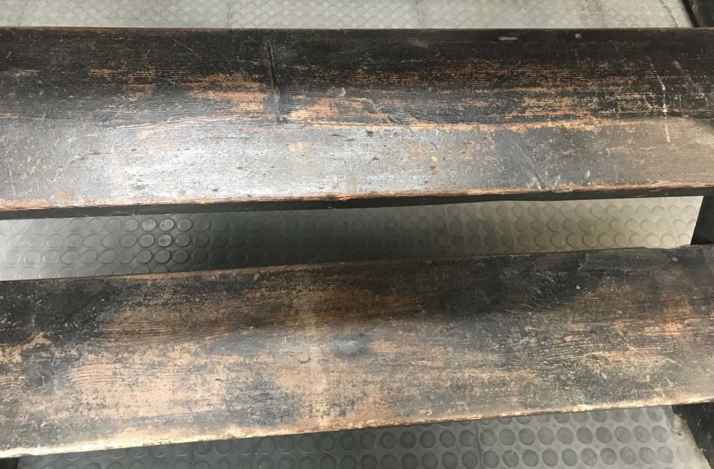 a close up of two wooden steps