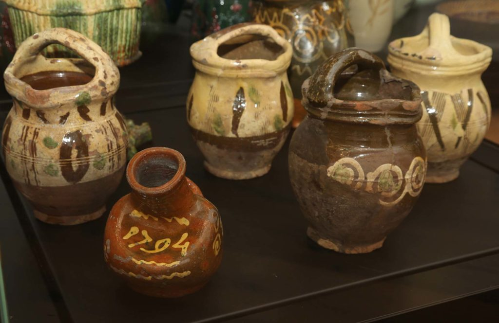 a ohoto of a collection of strangely shaped rustic looking pots