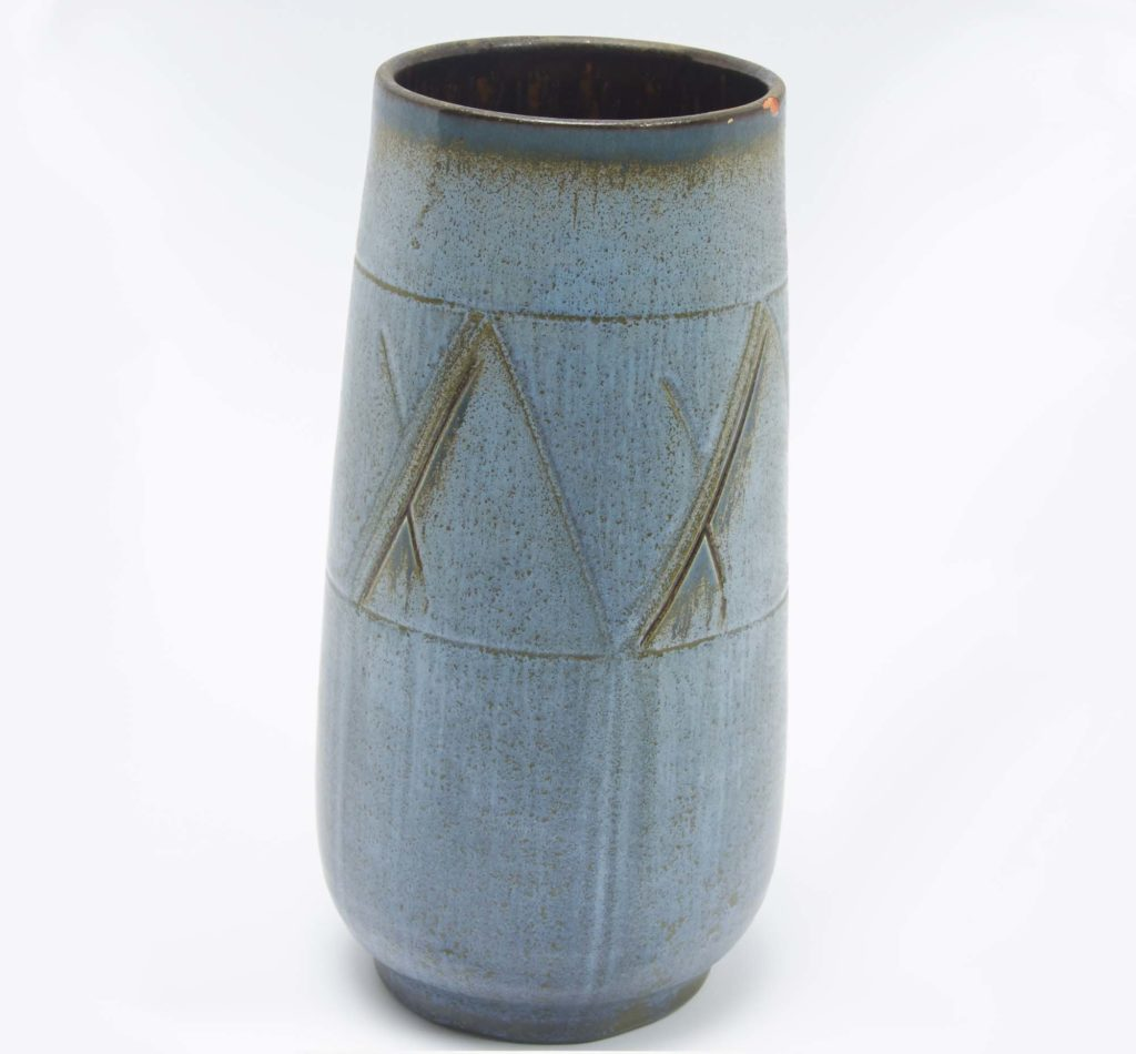 a photo of a blue vase with scraffito