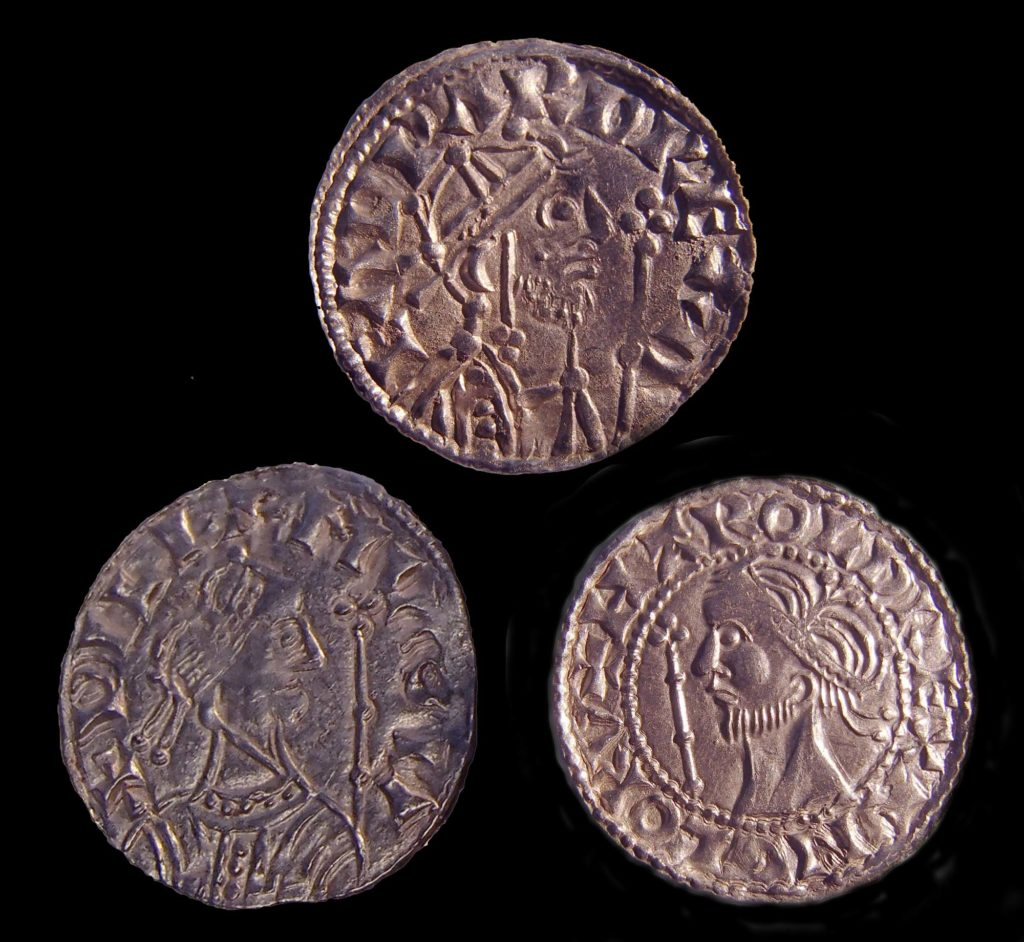 a photo of three medieval coins with kings heads on them