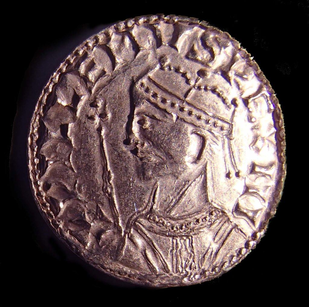 a photo of a medieval coin with a king in side profile