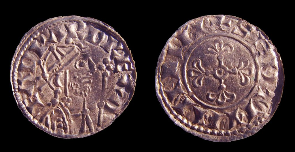 a front back photo of a coin showing a medieval king