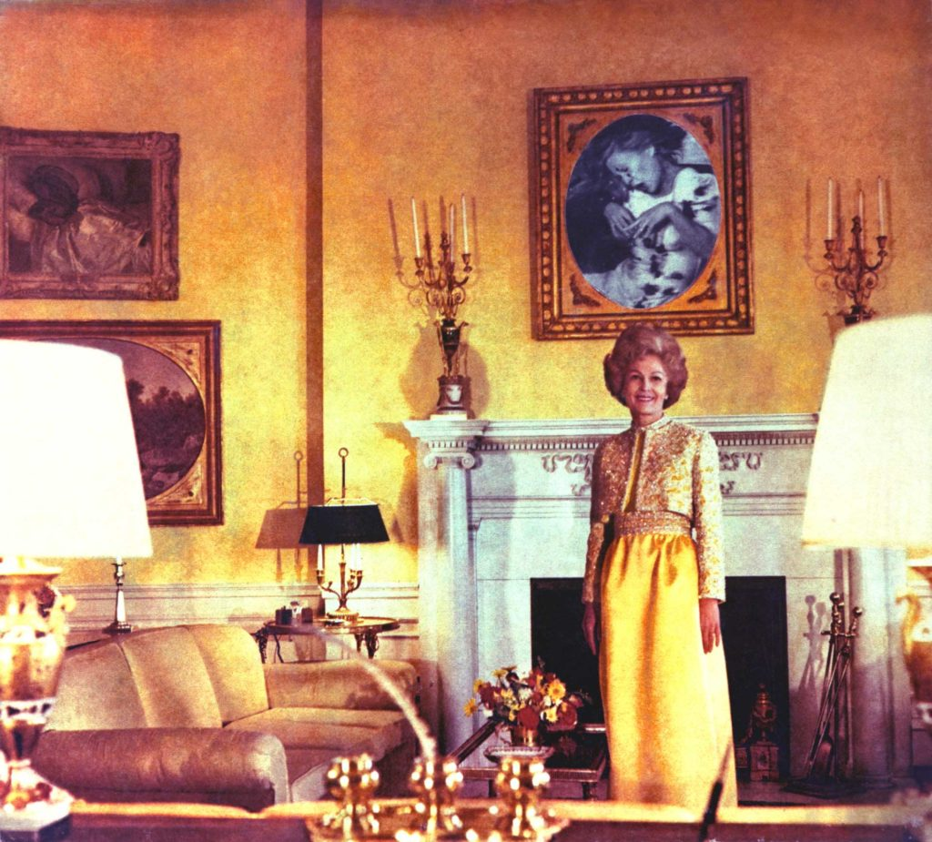 a colour photo of a woman wearing a yellow dress in a yellow-themed room