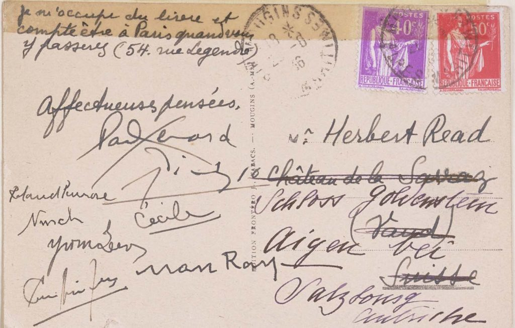 a photo of the back of postcard with signatures on it