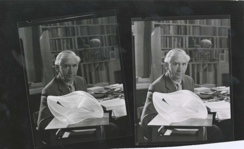 a double photo of Herbert Read holding an abstract sculpture
