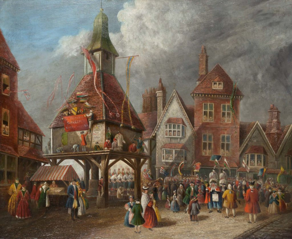 a painting of a traditional market cross building thronged with people and festooned with garlands