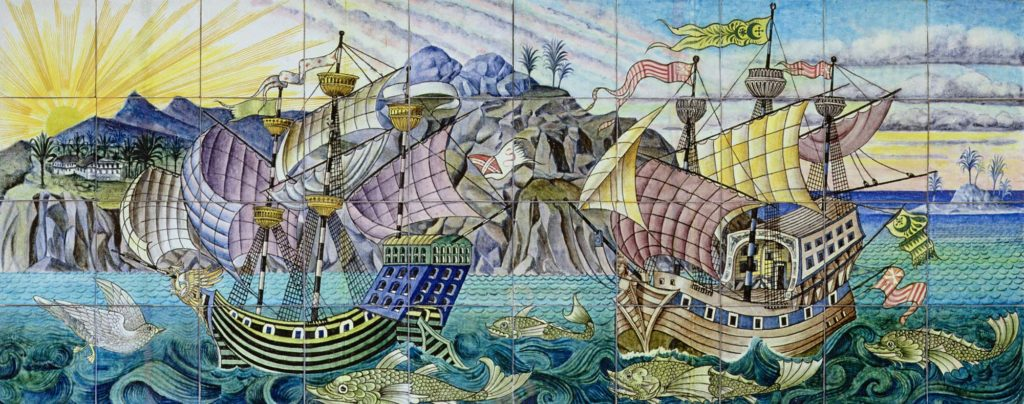 a decorative panel made up of painted tile depicting galleons in a bay