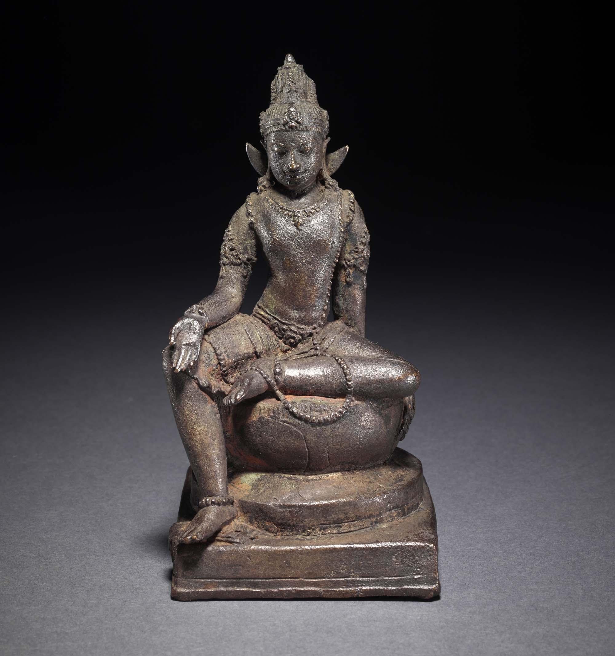 a classic bronze female Buddhist figurine