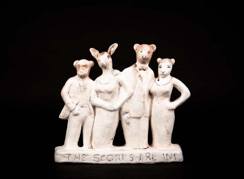 a porcelain figurine consisting of three figurines