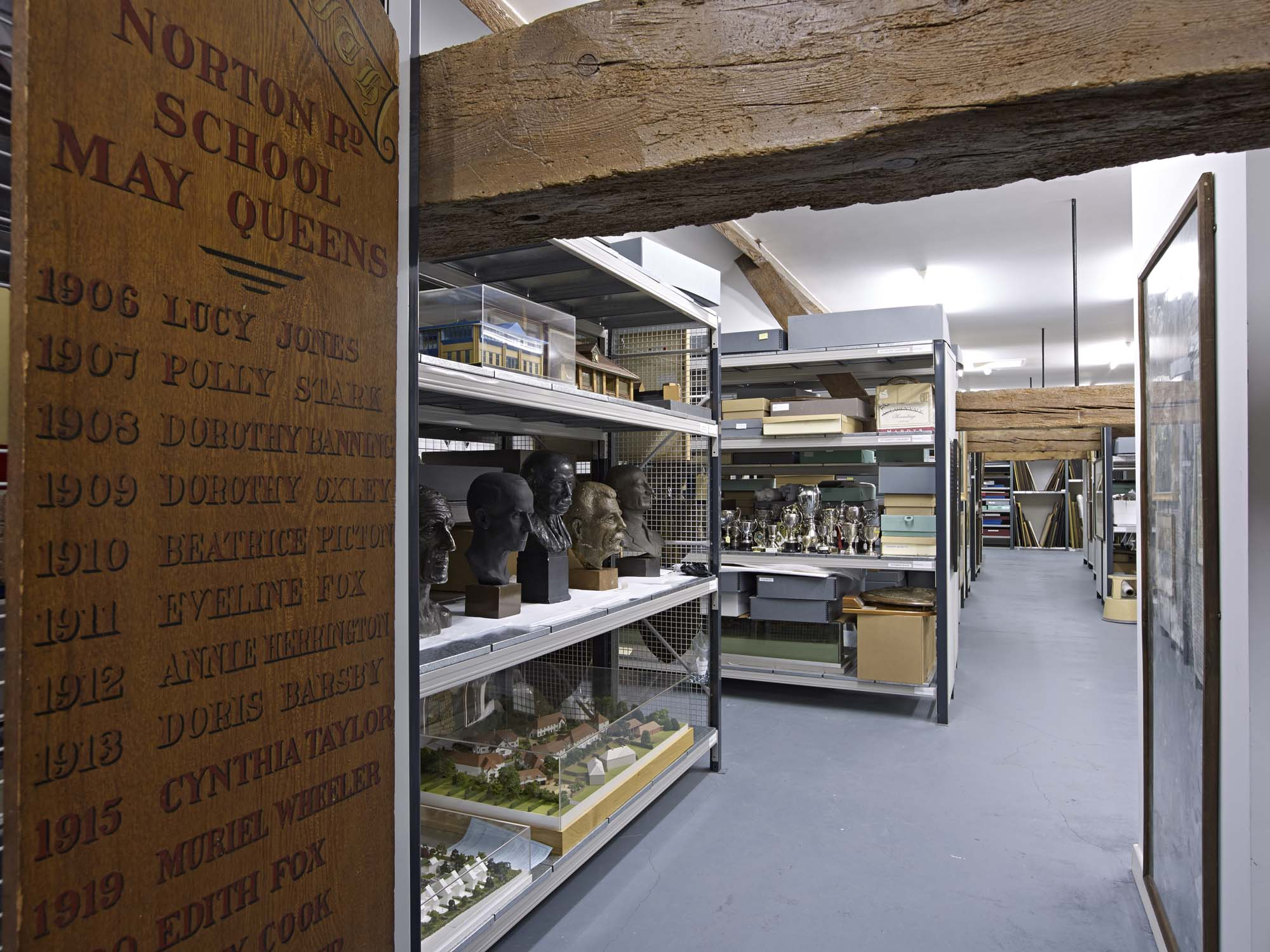 a photo of a store room filled with objects such as a series of sculpture busts