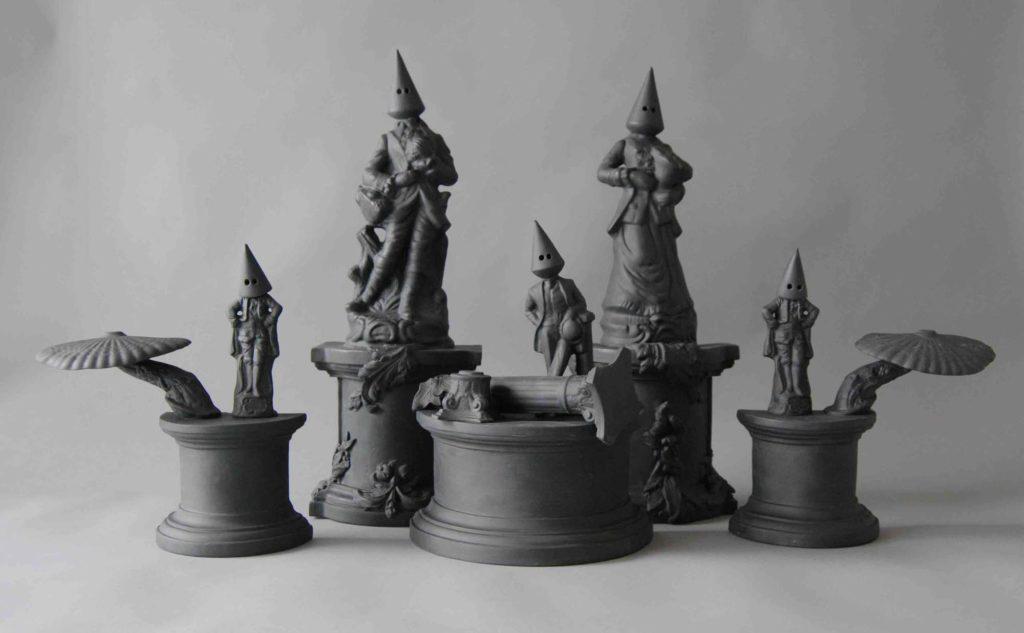 a group of porcelain figures on plinths