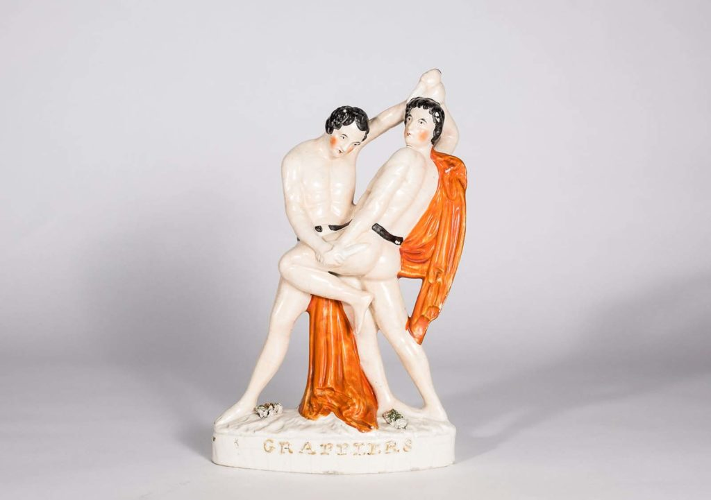 a ceramic of two male wrestlers grappling