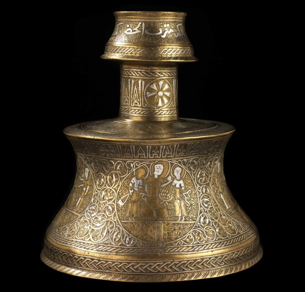 Candlestick of cast bronze engraved and inlaid with silver