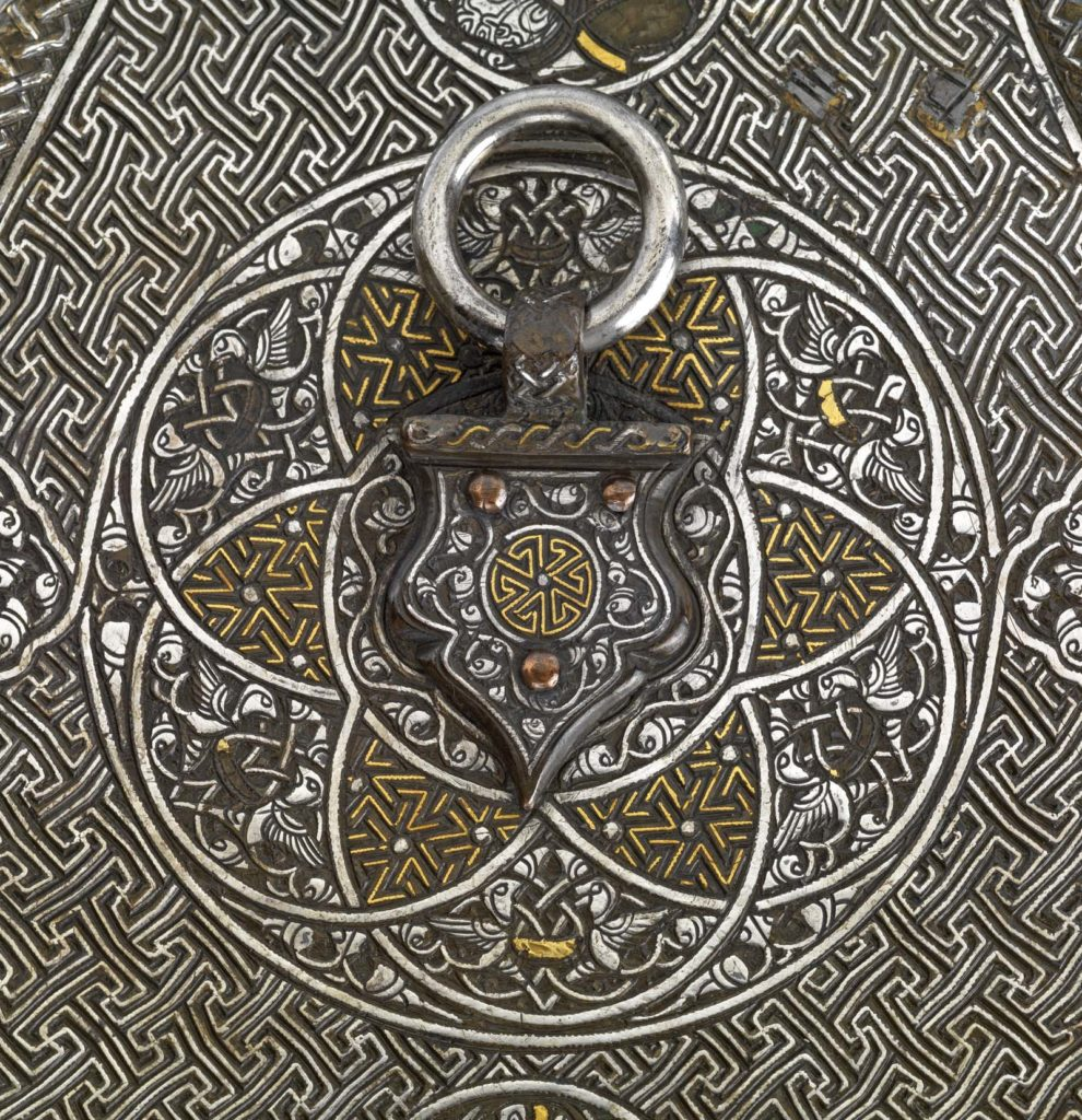 a close up photo of detailed Islamic styled metal work