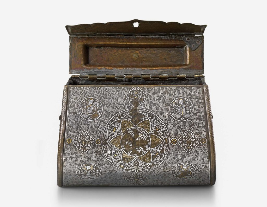 photo of a metal engraved handbag with hinged lid open