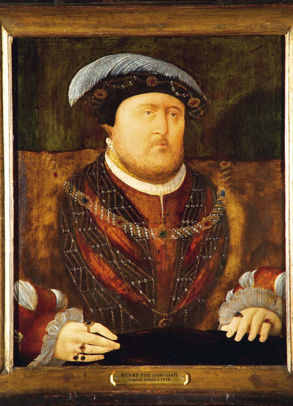 A portrait of Henry VIII in his robes and black felt hat with opulent feather