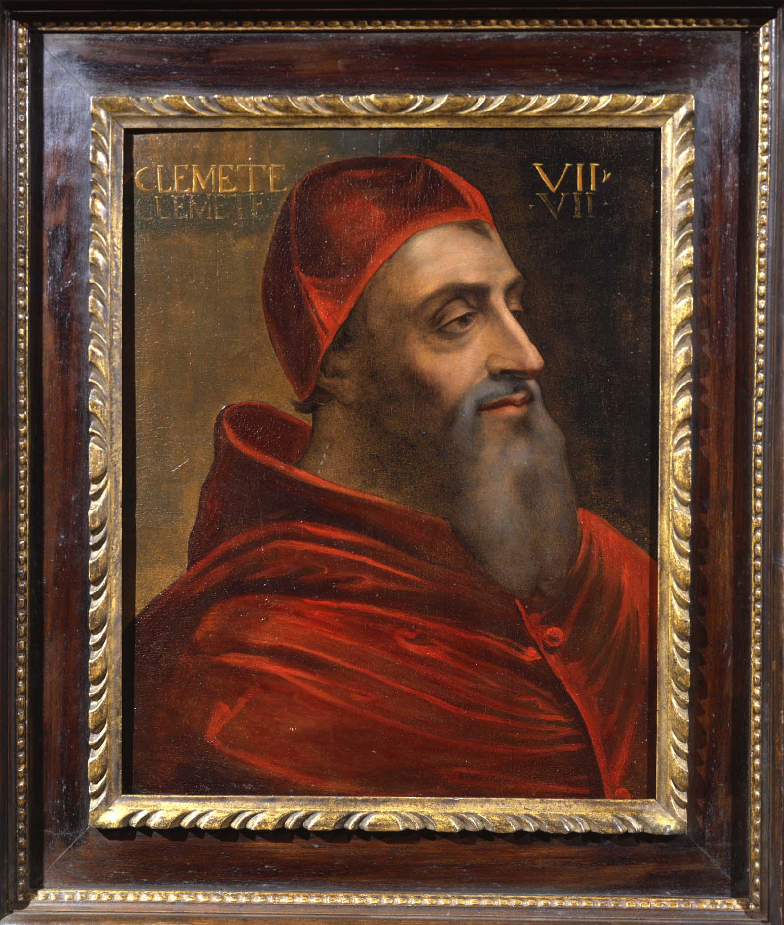 A portrait of Pope Clement in red robes, skull cap and long grey beard