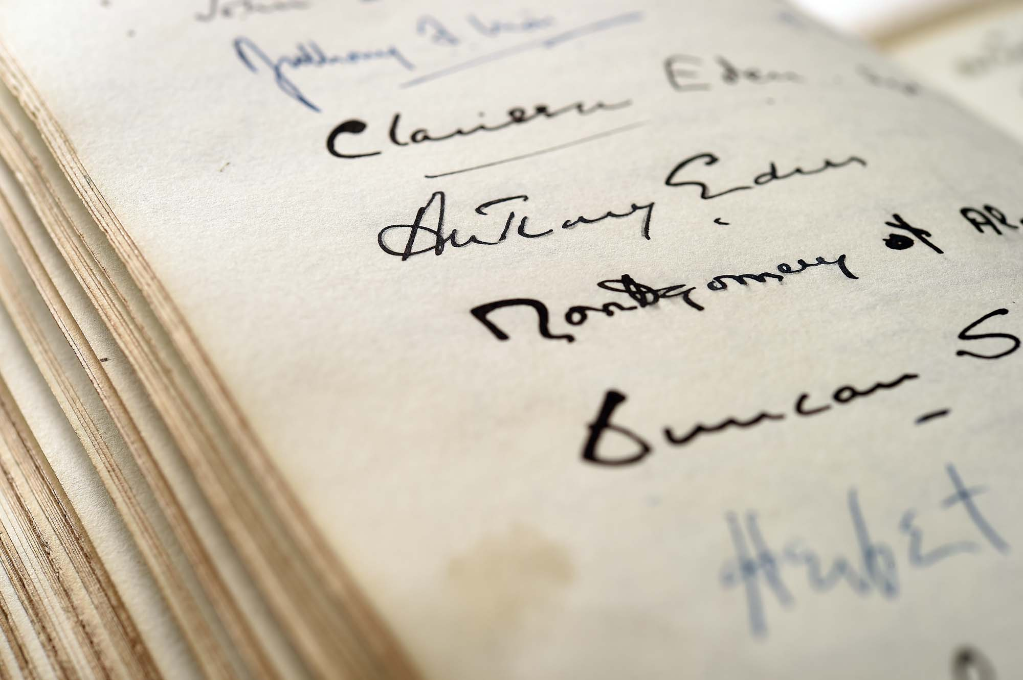 a photo of the open pages of a guest book with signatures