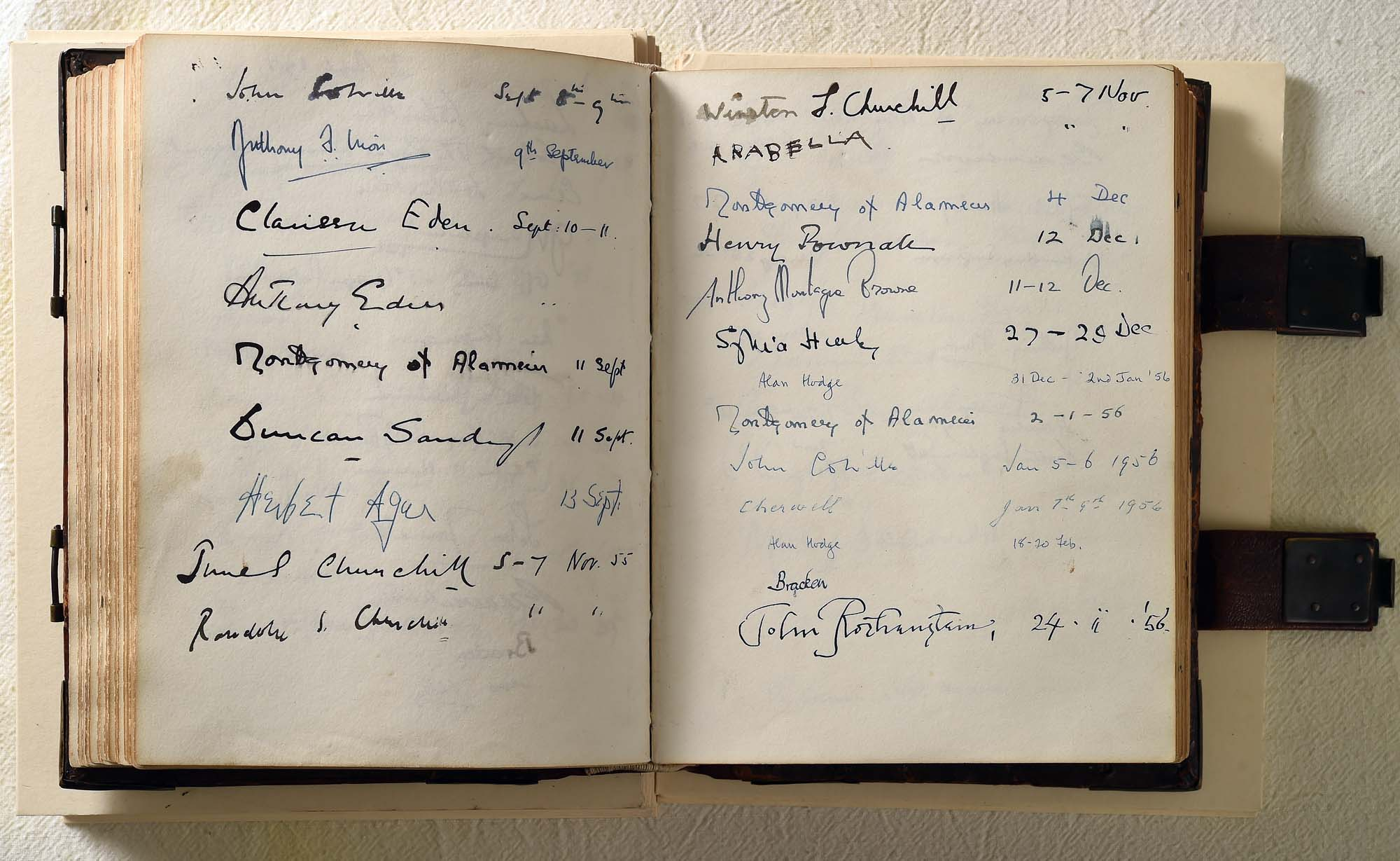 a photo of an open book with signatures and dates in it