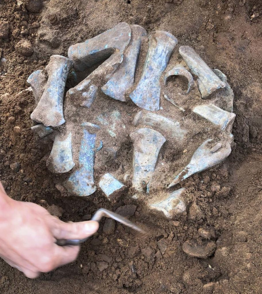 a photo of a pile of axes in excavation