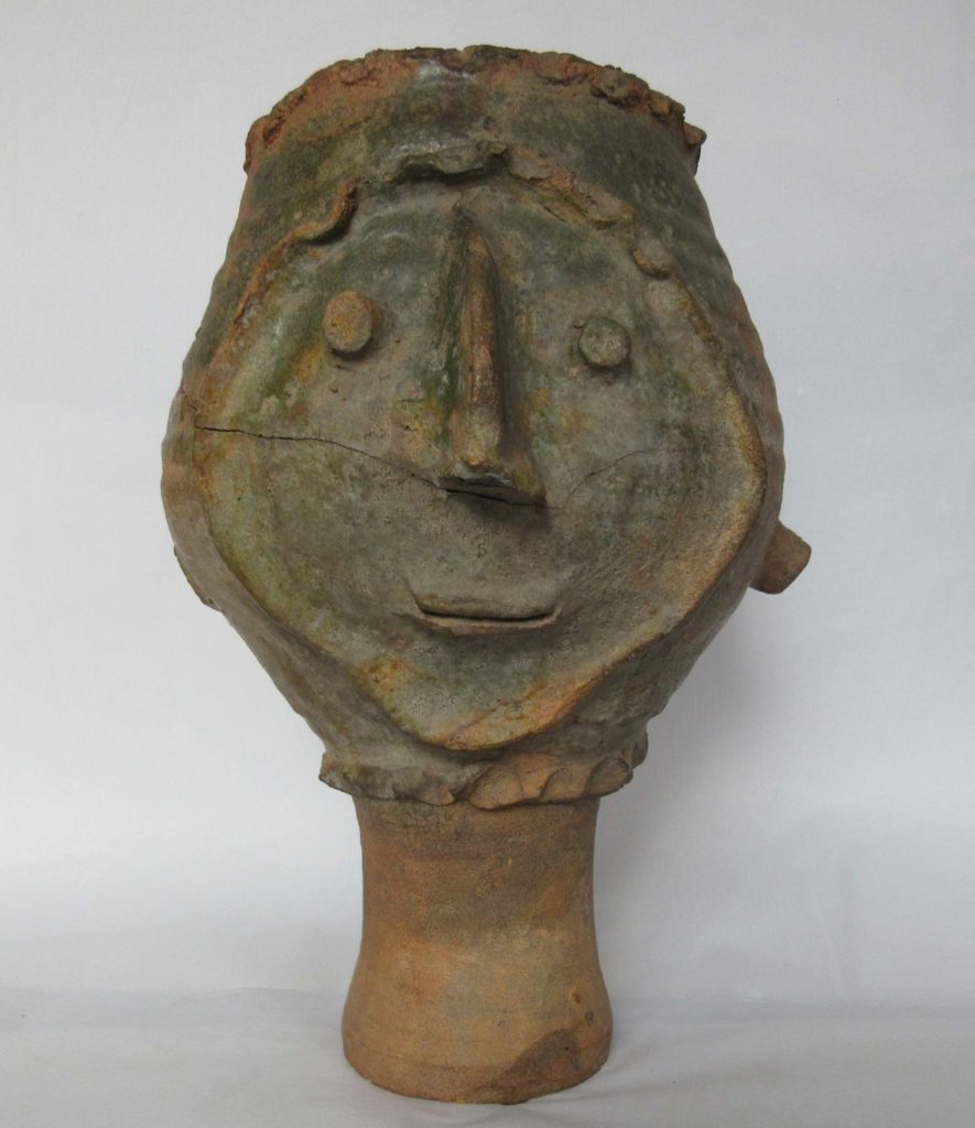 a photo of a pottery face