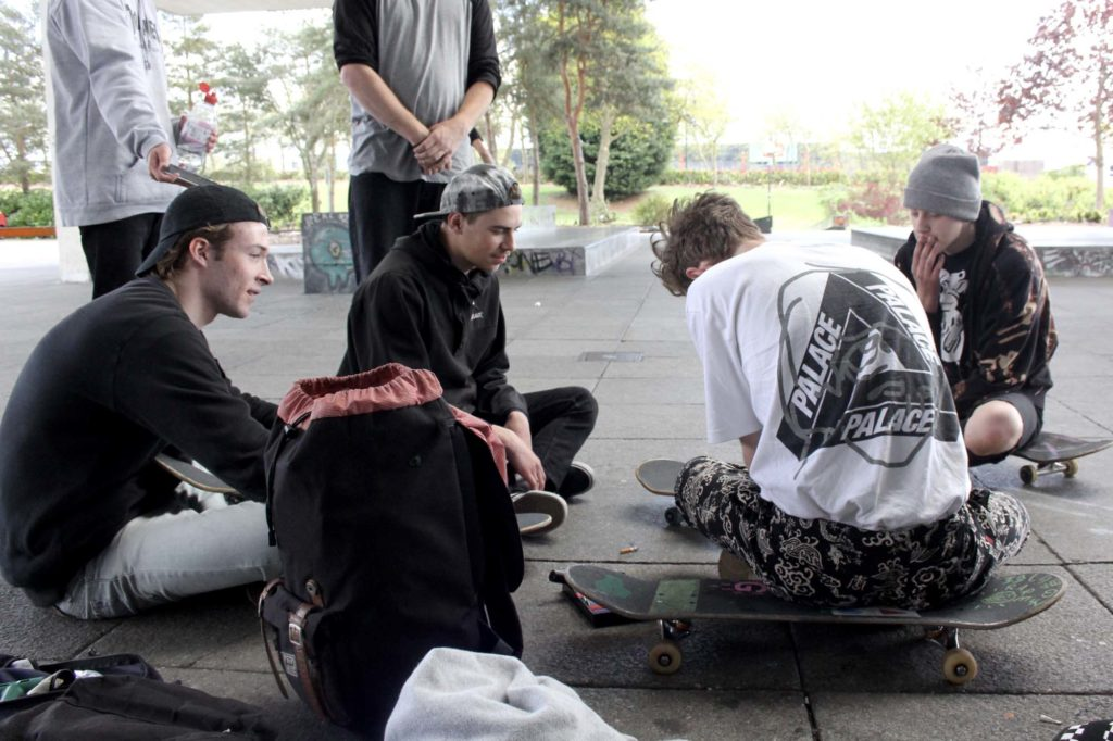 a photo of a bunch of teenagers on skateboards
