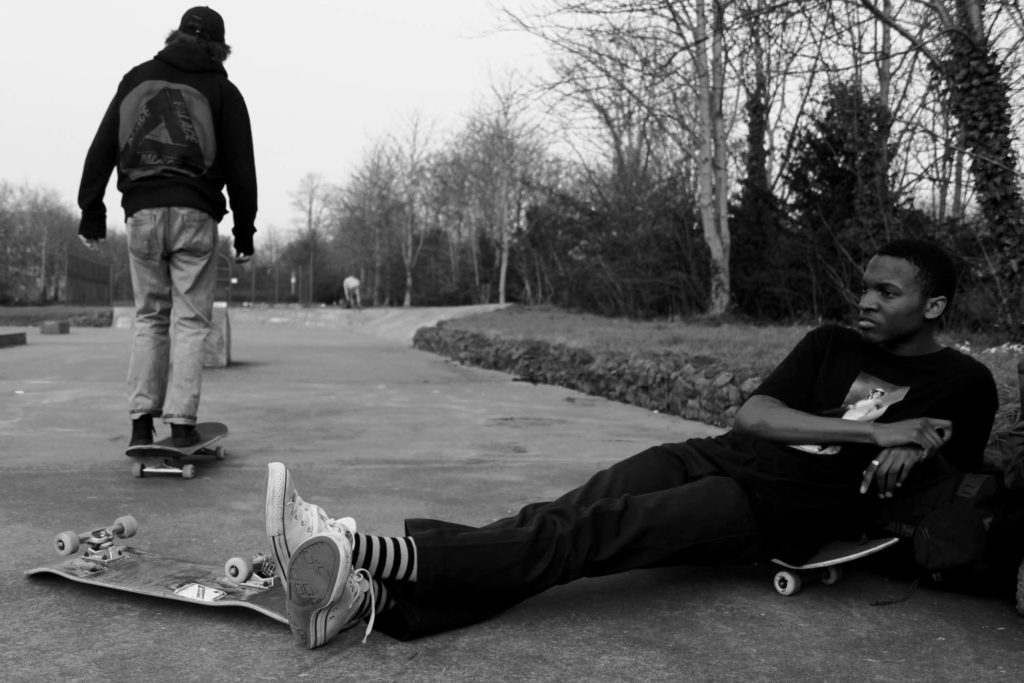 a photo of two young men at a skate park
