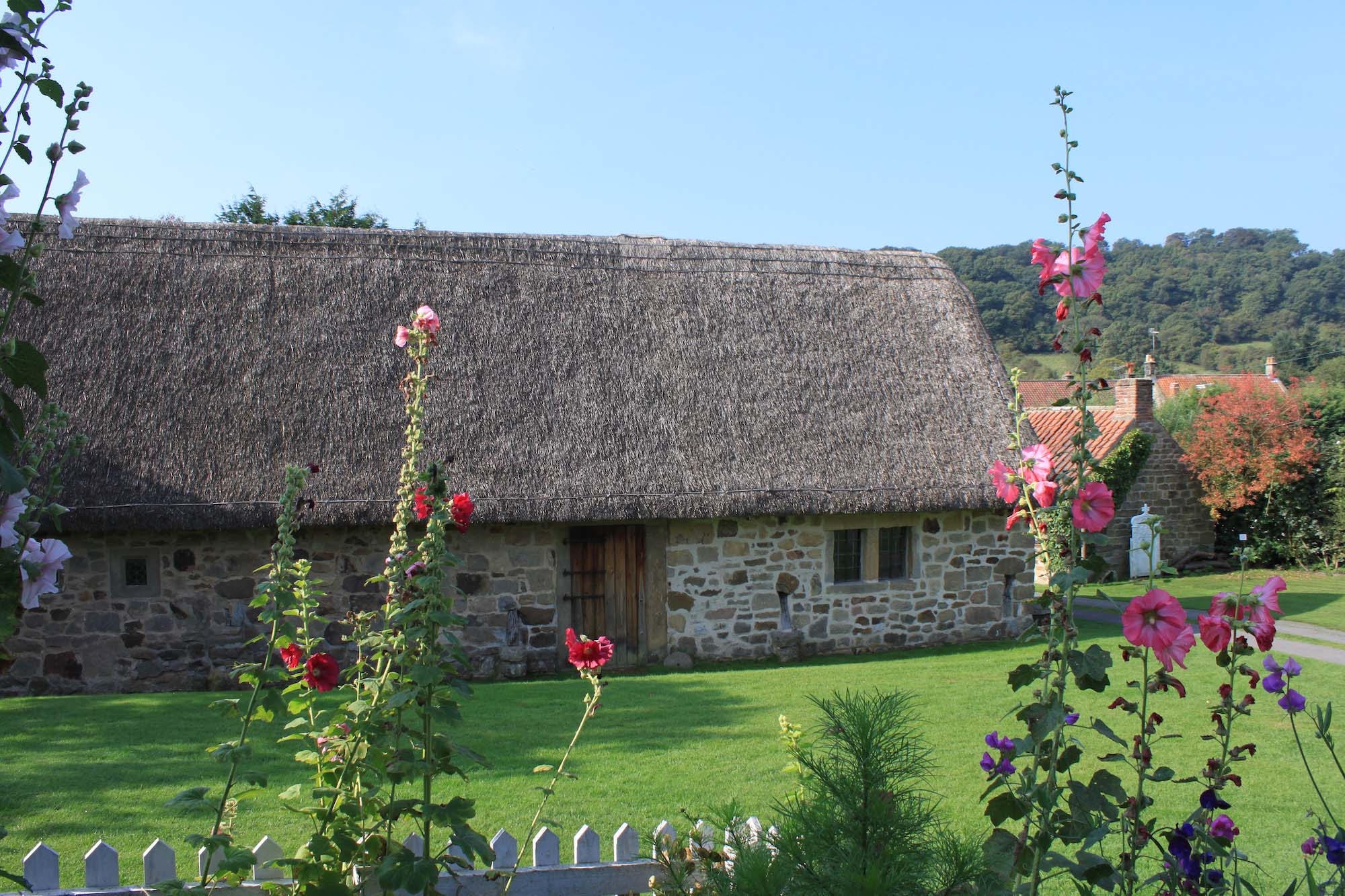 a colour photo of a single storey thatched cottage