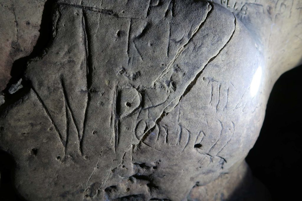 a photo of scratches and marks inside a cave