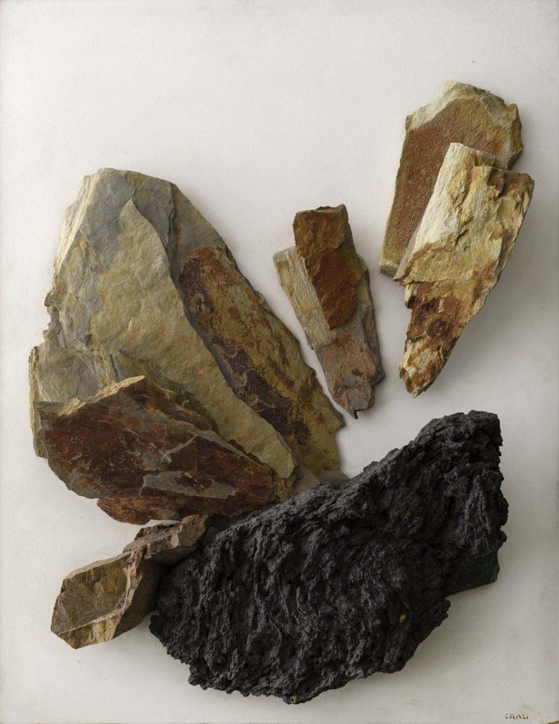 a photo of three pieces of artistically arranged rocks