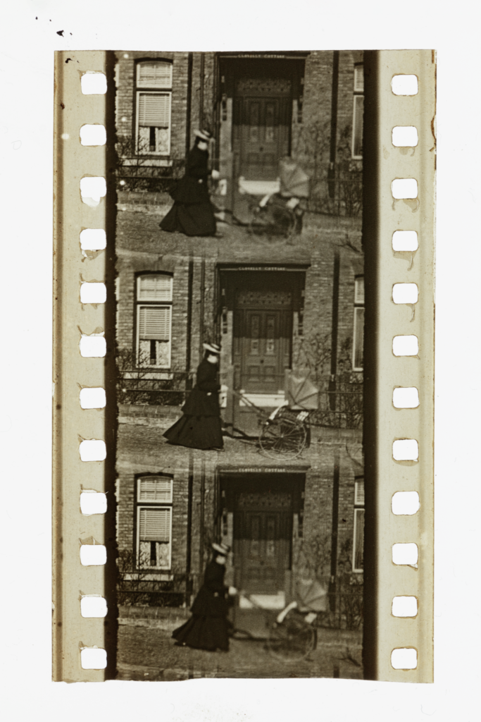 a section of film showing three frames, depicting a woman pushing a pram