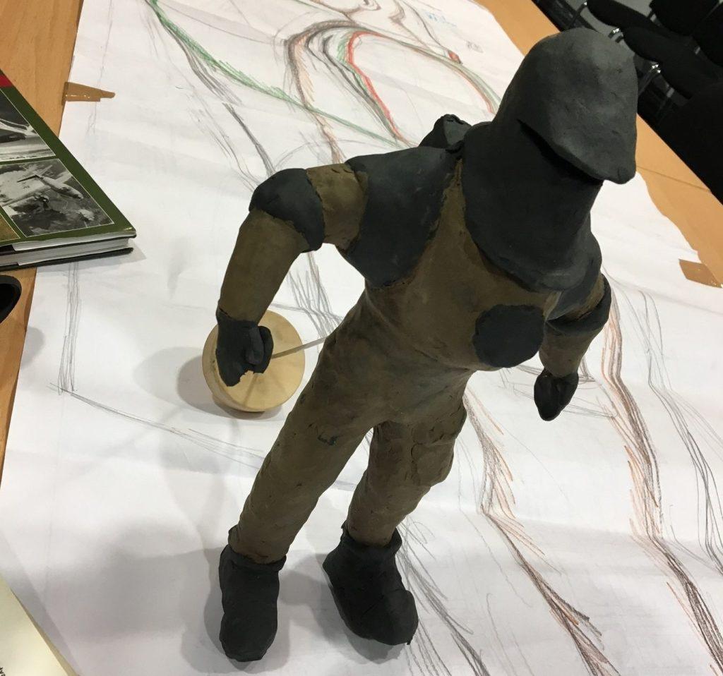 a photo of a plasticine model astronaut figure