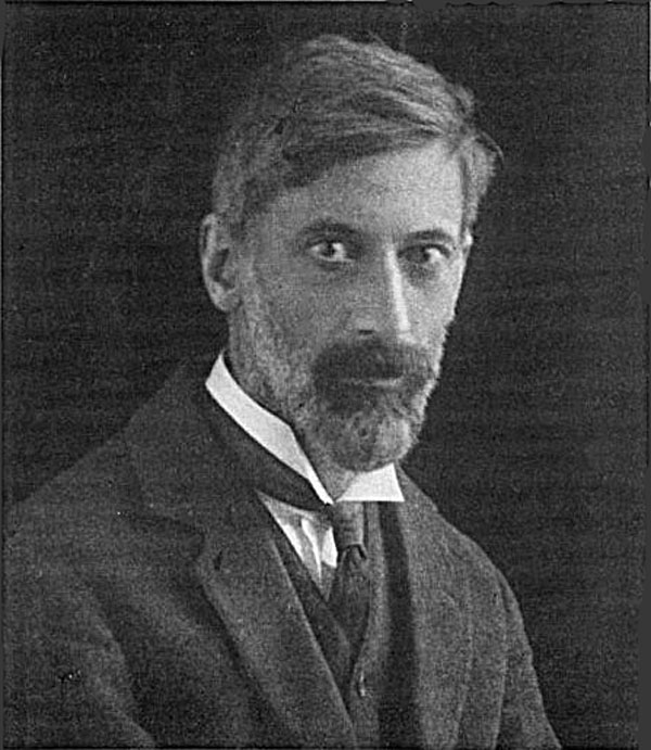 a photo of a bearded man in suit and tie