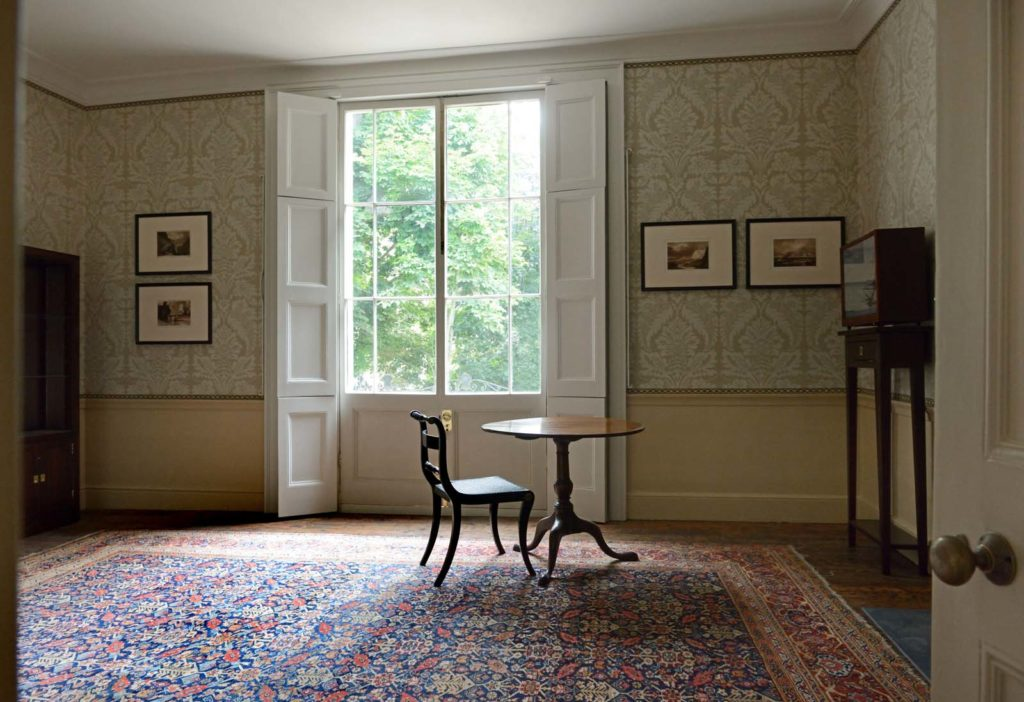 a photo of a sitting room with a bay window and single chair