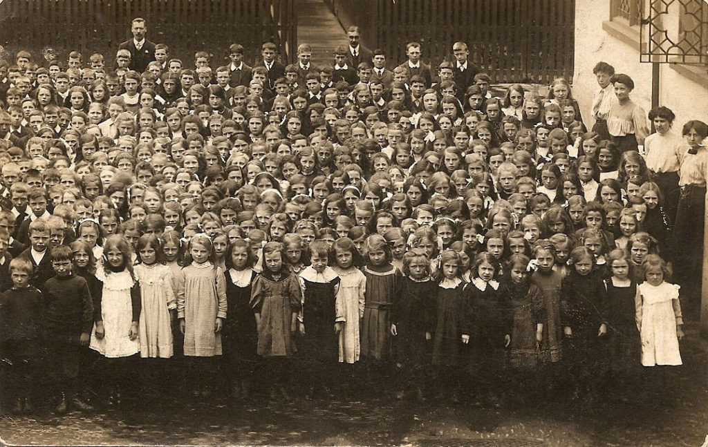 a large group of schoolchildren with their teachers
